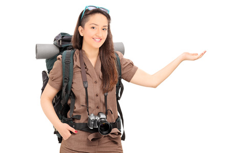 adventurer: Female tourist gesturing with hand isolated on white background