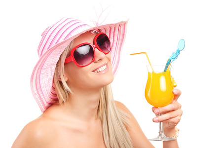 Trendy woman drinking an exotic cocktail isolated on white background photo