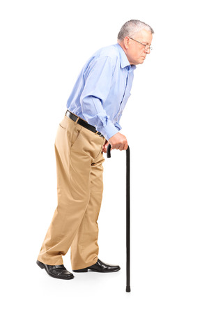 old people walking: Old man walking with cane isolated on white background