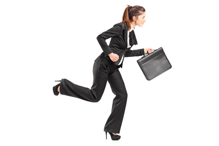 business briefcase: Businesswoman running with a briefcase isolated on white background