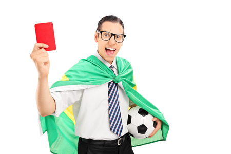 Football fan with Brazilian flag showing red card isolated on white background photo