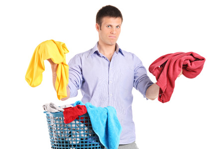 indecisive: Indecisive man holding two sweaters isolated