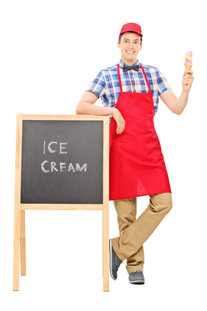 vendors: Full length portrait of an ice cream vendor standing by a blackboard isolated on white background