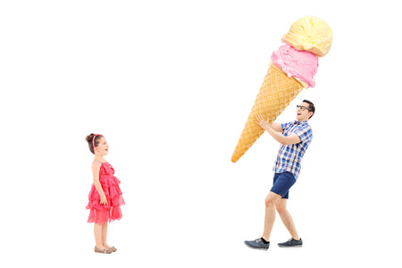 Man bringing huge ice cream to excited girl isolated on white background