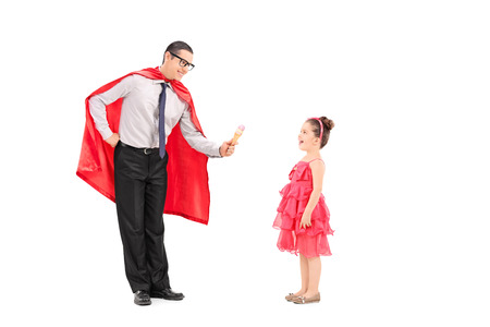hero giving an ice cream to a little girl isolated on white background photo