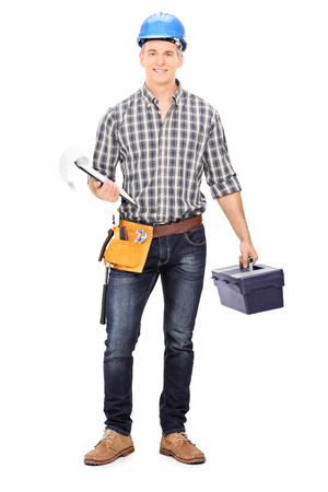 Full length portrait of an engineer holding a toolbox and a clipboard isolated Stock Photo