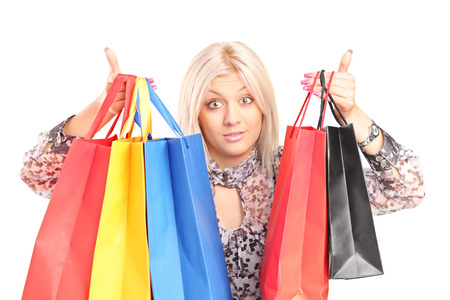 Surprised woman holding shopping bags isolated  photo