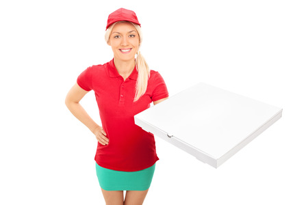 Delivery girl holding a box of pizza isolated on white background photo