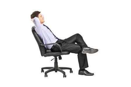 hombre sentado: El hombre tranquilo sentado en una silla de oficina aislada en el fondo blanco Foto de archivo
