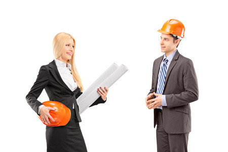 Female architect and investor having a conversation isolated against white background photo