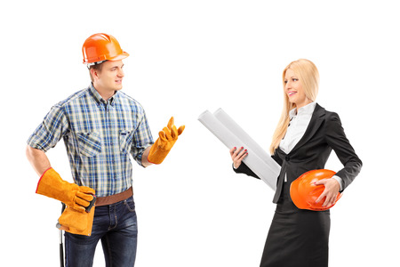 Male manual worker having a conversation with female architect, isolated on white background photo