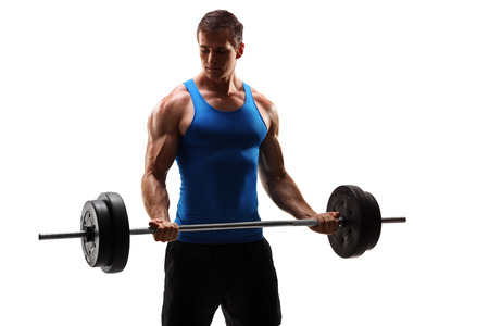 Male bodybuilder exercising with a barbell isolated on white background Imagens