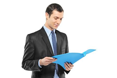 fascicule: Businessman reading a document isolated on white background