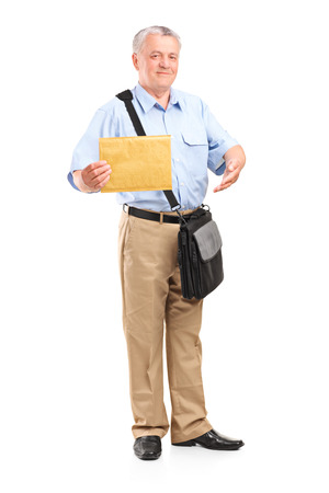 postman: Full length portrait of a mature mailman holding an envelope isolated on white background