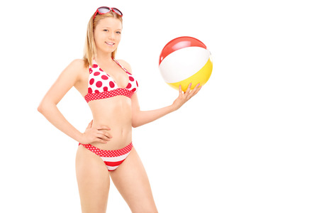 beach ball girl: Attractive woman in bikini holding a beach ball isolated on white background Stock Photo