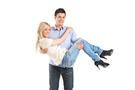 carrying: Young man carrying his girlfriend isolated on white background Stock Photo
