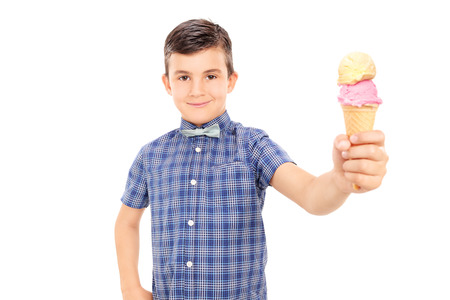 Cute little boy holding an ice cream isolated on white background photo