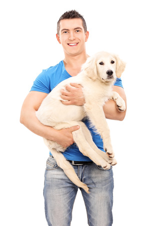 man dog: Smiling young man holding a dog isolated on white background
