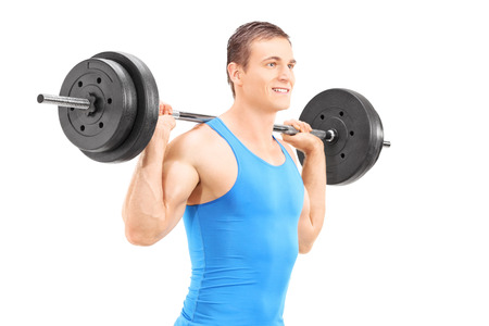 heavy lifting: Young man lifting a barbell isolated on white background Stock Photo