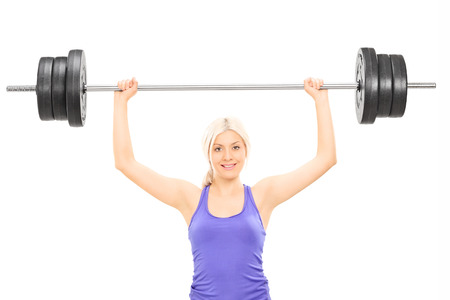 weightlifter: Blond female athlete lifting a heavy barbell isolated on white background