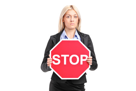 woman stop: Businesswoman holding a stop sign isolated on white background