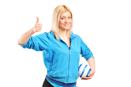 Professional female handball player giving thumb up isolated on white background photo