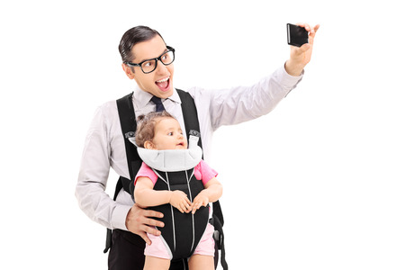 Young father taking selfie with his baby daughter isolated on white background photo