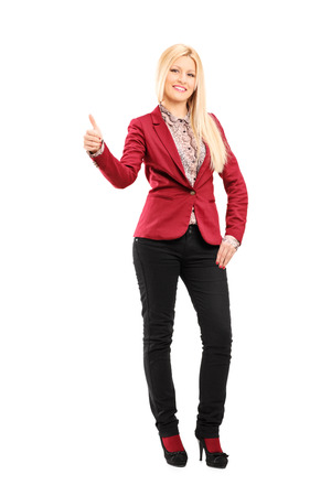 Full length portrait of a trendy woman giving a thumb up isolated on white background photo