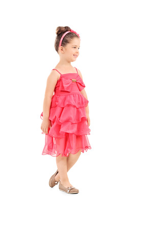 girl in red dress: Full length portrait of a cute little girl in a red dress isolated on white background Stock Photo