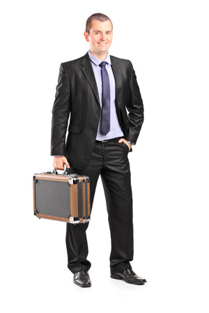 Full length portrait of a handsome businessman holding a briefcase isolated on white background photo