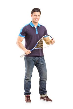 racquetball: Retrato de cuerpo entero de un joven jugador de racquetball masculino aislado en el fondo blanco Foto de archivo