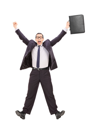 Full length portrait of an overjoyed businessman shot in mid-air isolated on white background photo