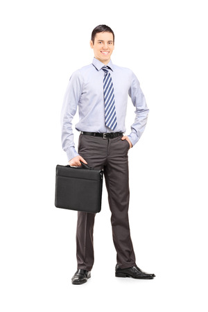business briefcase: Full length portrait of a young confident businessman posing isolated on white background Stock Photo