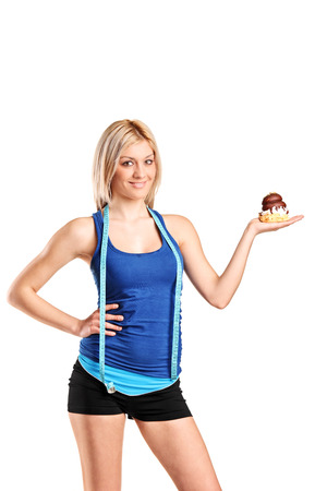 woman measuring: Beautiful woman holding a cake isolated on white background