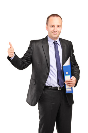 Businessman holding an empty folder and giving a thumb up isolated on white background photo