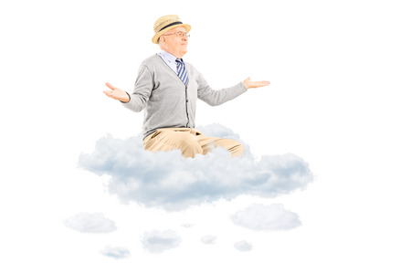 Senior gentleman gesturing with hands seated on a cloud isolated on white background photo