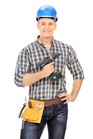 Male carpenter holding an electric drill isolated on white background photo