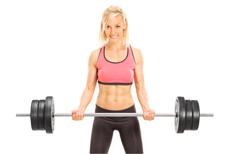 Female bodybuilder holding a barbell isolated on white background photo