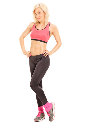 yoga pants: Full length portrait of an attractive woman in sportswear posing isolated on white background Stock Photo