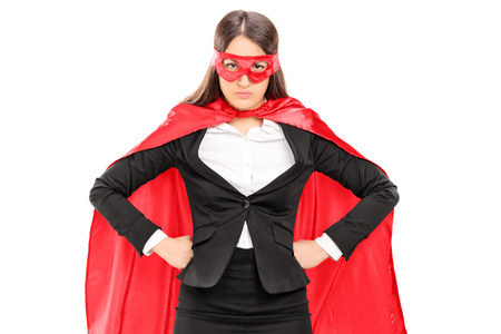 Woman in superhero costume standing proudly isolated on white background Imagens - 30087287