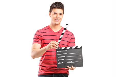 filmmaker: Young filmmaker holding a movie-clapper isolated on white background Stock Photo