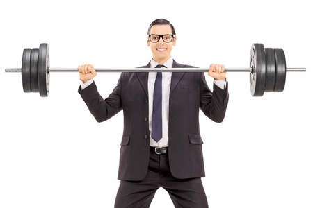 hardworking: Businessman holding a heavy weight isolated on white background