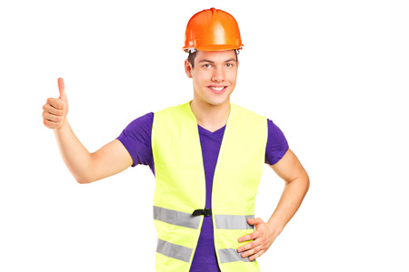 Male construction worker giving a thumb up isolated on white background photo