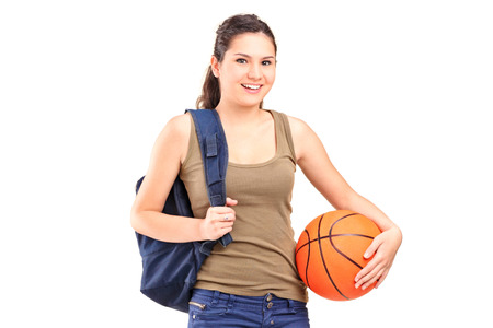 Young woman holding a basketball isolated on white background photo