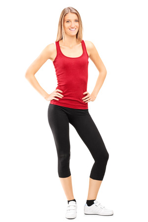 Full length portrait of a woman in sportswear posing isolated on white background photo