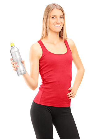 Vertical shot of a young woman holding a water bottle isolated on white background photo