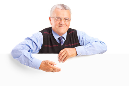 people from behind: Senior gentleman behind a white billboard isolated on white background Stock Photo