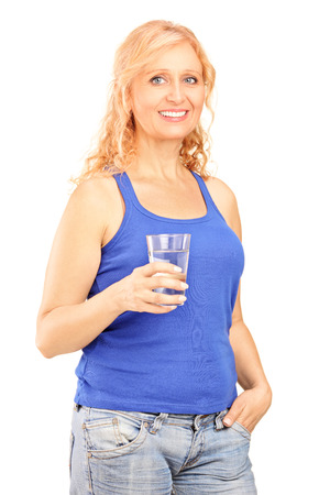 Mature woman holding a glass of water isolated on white background photo
