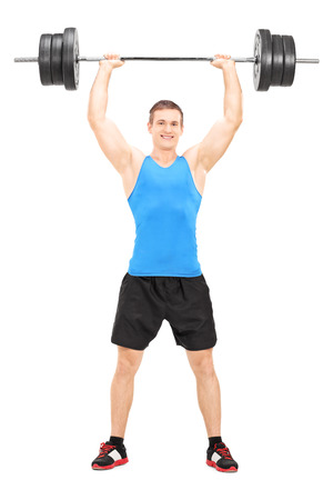 weightlifter: Full length portrait of a male weightlifter holding a barbell isolated on white background Stock Photo