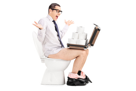 relieved: Overjoyed man holding a briefcase full of toilet paper seated on a toilet isolated on white background